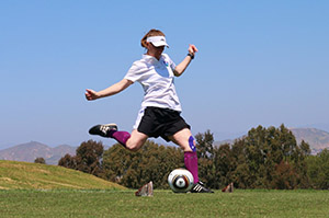 FootGolf player kicking the ball